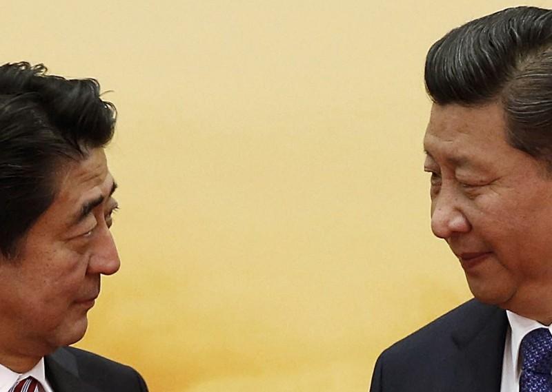 日本首相安倍晉三與中國國家主席習近平。(路透資料照)