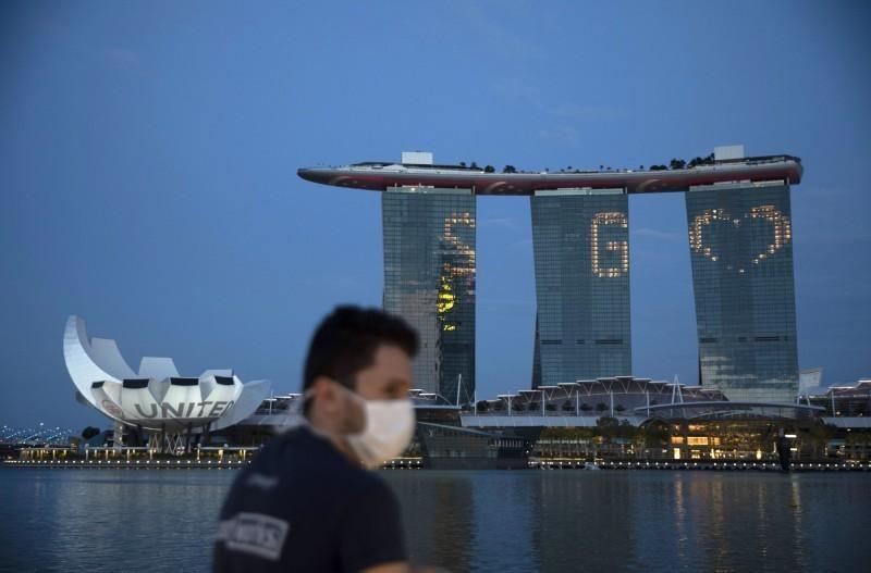 武漢肺炎(新型冠狀病毒病,COVID-19)疫情蔓延,新加坡今日宣布再添加347例新確診案例後,讓全國確診者人數突破4萬大關。(歐新社)