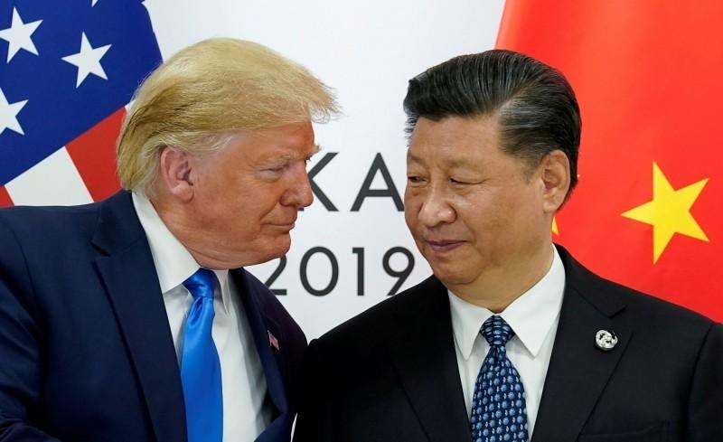 中國領導人習近平(右)、圖左為美國總統川普。(路透)