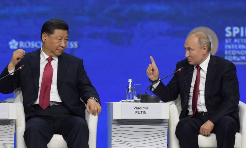 中共國家主席習近平和俄羅斯總理普亭。(法新社資料照)