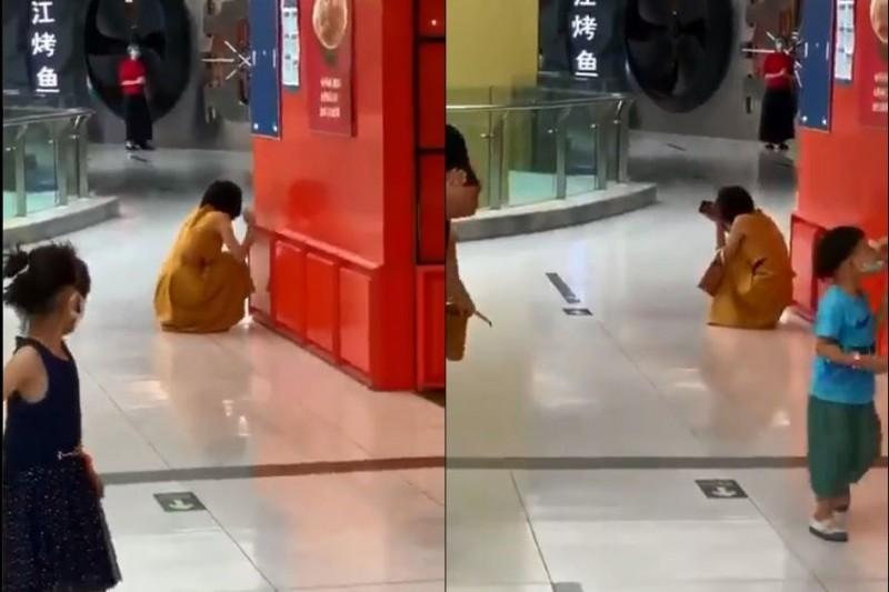 北京一女子逛石景山萬達廣場時,突接獲醫院通知「確診」武漢肺炎的電話,當場崩潰大哭。(本報合成圖)