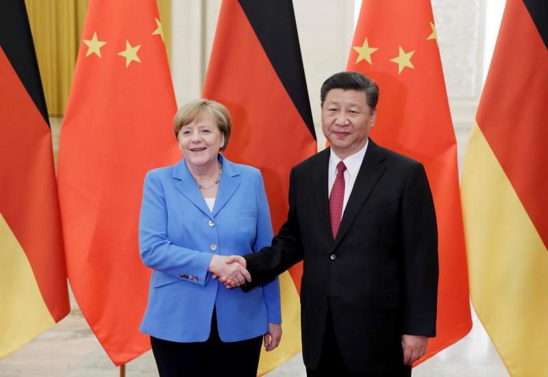 德國總理梅克爾任內曾12度訪問中國。(路透檔案照)