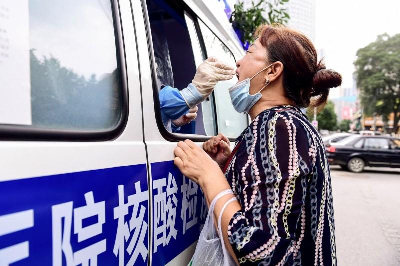 中國單日新增127例確診,是近期新高。(法新社)