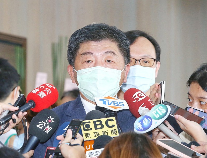 Minister of Health and Welfare Chen Shih-chung speaks to reporters about disease prevention measures in Taipei yesterday. Photo: CNA