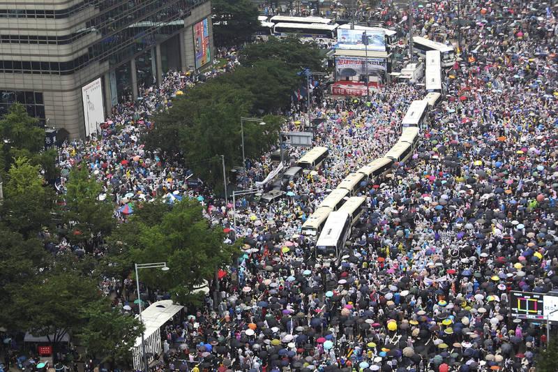 南韓「愛第一教會」負責牧師全光焄在15日號召民眾上街示威遊行,17日防疫當局宣布全光焄確診。(美聯社)