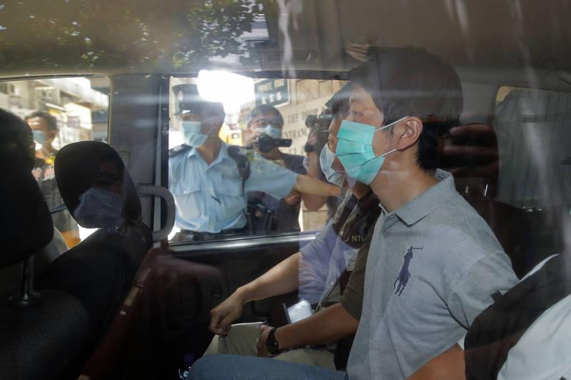 許智峯(見圖)被捕至警署後,目前出現身體不適狀況,目前已經送往醫院,但警方仍然拒絕他申請保釋。(美聯社)