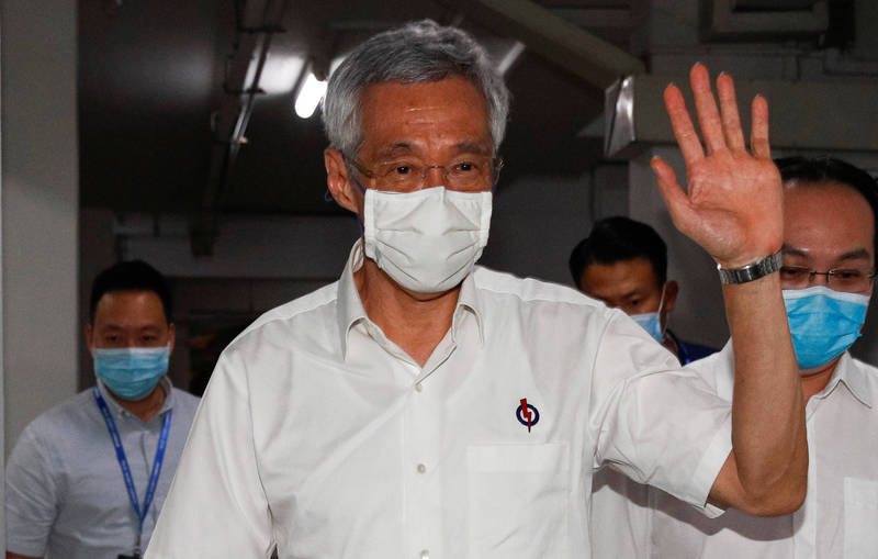 新加坡總理李顯龍(見圖)承認該國防疫政策有缺失。(路透檔案照)