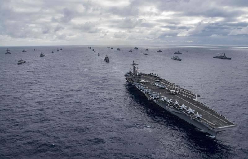 國際政經預言家Master Wong認為,全球若爆發單一地緣戰爭,恐於10月演變成世界大戰。圖為2018年環太平洋軍演中由美軍帶領的跨國編隊。(法新社檔案照)