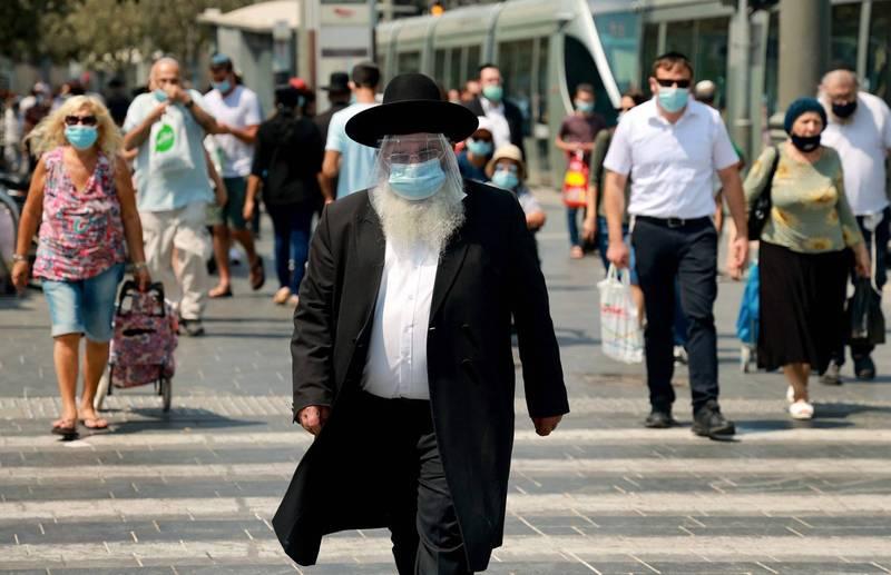 以色列的武漢肺炎(新型冠狀病毒病,COVID-19)疫情再度爆發,將於18日開始展開3週的全國封鎖。(法新社)