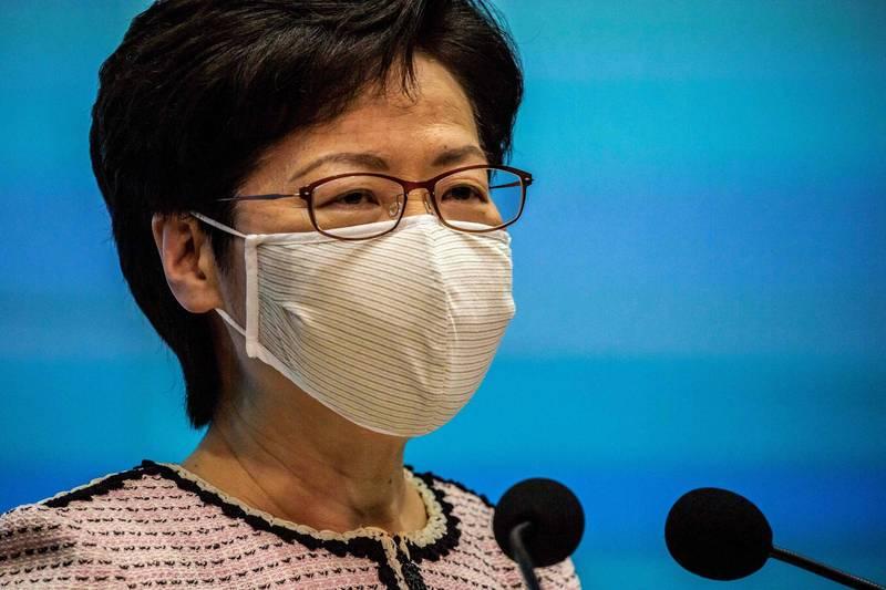 林鄭月娥昨表示,香港第三波武漢肺炎疫情已經受控,但今日再度新增病例。(法新社)