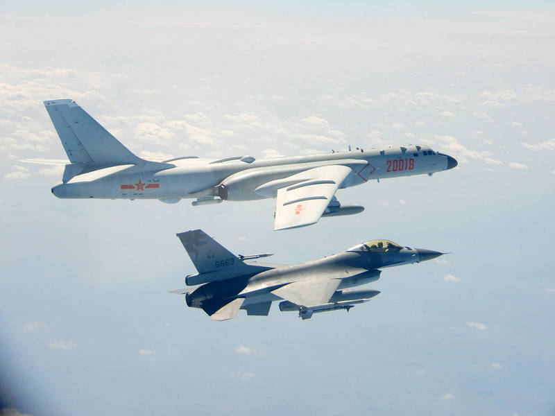 A Taiwanese F-16 jet flies below a Chinese H-6 bomber on Feb. 10. Photo: Reuters / Ministry of National Defense