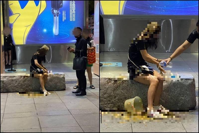 台北市信義區威秀影城中庭昨深夜驚傳有女子遭一名男子當街用一桶屎從頭砸下,導致全身佈滿穢物。(圖擷自爆料公社)