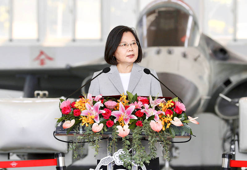President Tsai Ing-wen speaks to members of an air force fighter squadron in a hangar at Penghu Airport in Penghu County's Magong City yesterday. Photo: CNA