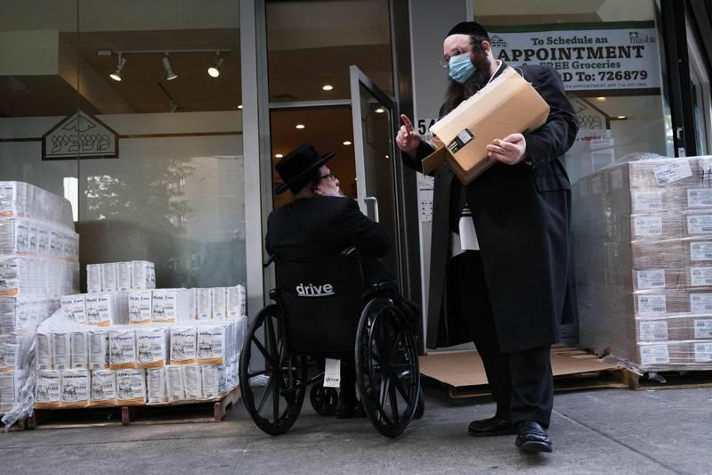 疫情期間,紐約布魯克林社區街友數量增多,服務處服務量驟增。(法新社)