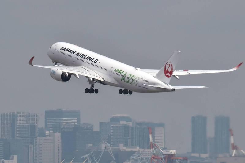 日本航空宣布,機上英語廣播將不再出現「女士、先生們」,將改成中性用詞。(法新社)