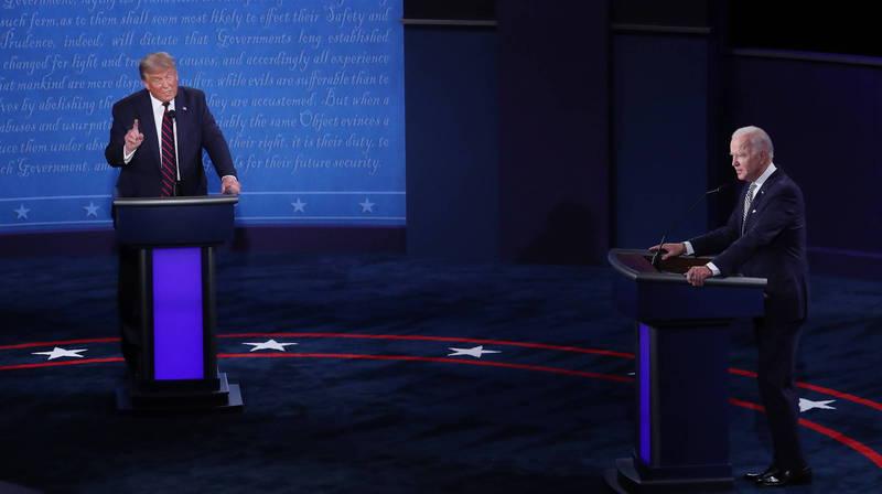 美國總統川普與民主黨候選人拜登一開始就火藥味十足。(歐新社)