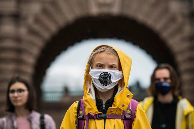 美國大選進入倒數階段,不過美國總統川普對於氣候議題,總與瑞典「環保少女」童貝里不對盤,因此童貝里選擇立挺拜登。(法新社)
