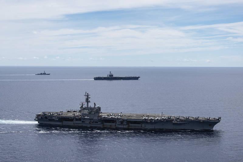 美國海軍雷根號航艦打擊群原先預計9日開始將在印度洋進行巡航,不過根據中國擁有官方背景的智庫「南海戰略態勢感知計畫」(SCSPI)在13日宣布,聲稱雷根號航艦打擊群在12日突然轉向返回南海。(美聯社)