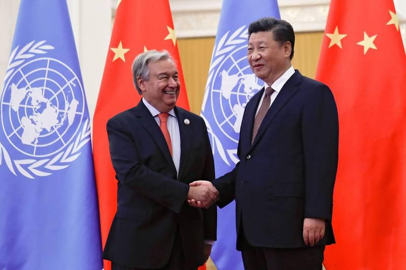 中國與聯合國合作密切,引國際擔憂。圖為中國國家主席習近平(右)及聯合國秘書長古特瑞斯。(路透)