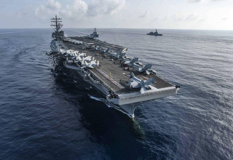 前中共海軍司令部中校指出,中共攻台是為顧及面子問題,但中方目標是美軍。圖為美國航艦雷根號。(歐新社檔案照)