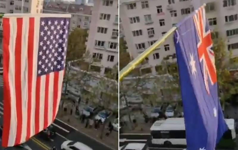 青島維權人士隋雙勝不畏打壓,在家中掛出美國、英國的國旗,並一一喊出中共的惡行,高喊「民主萬歲,獨裁必亡」,影片發布後引發網友討論。(圖取自推特)