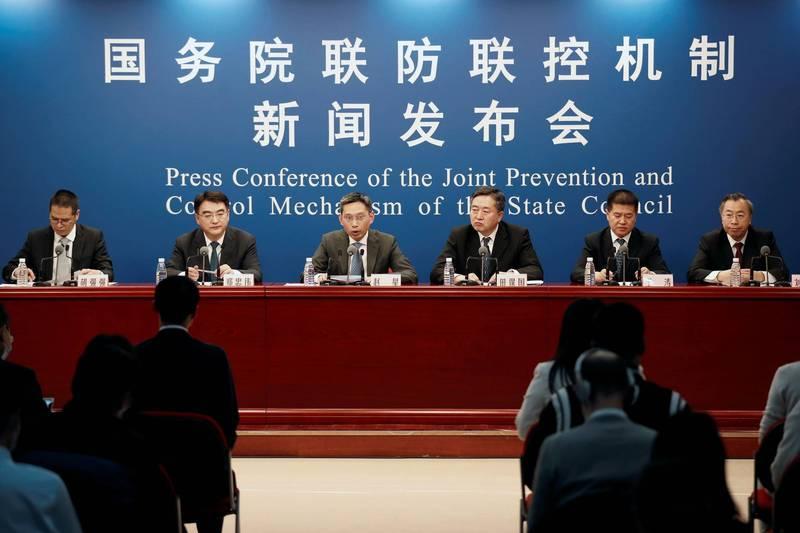 中國國務院聯防聯控機制昨日召開記者會說明中國武漢肺炎疫苗研發現況。(路透)