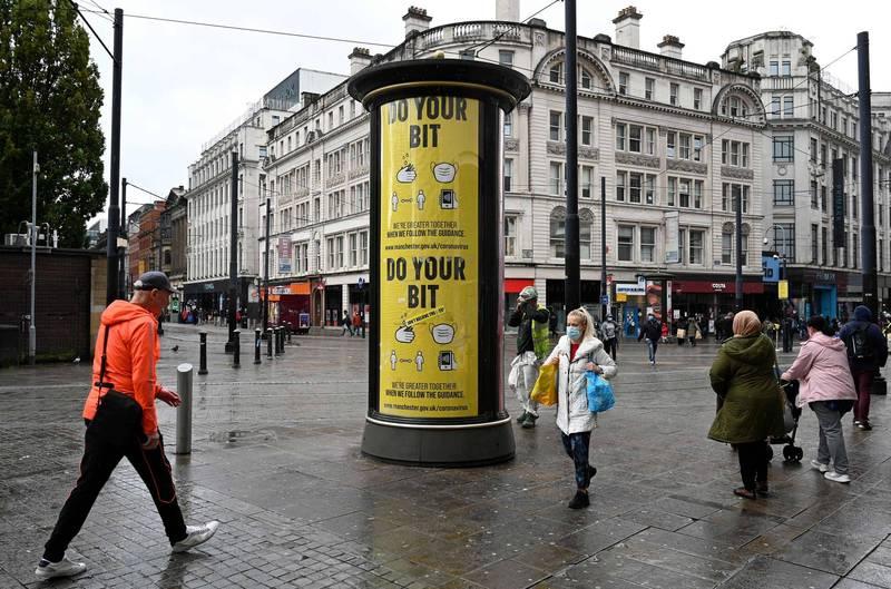 英國近日疫情再升溫,當局宣布自週五起將把曼徹斯特的疫情警報等級提升至非常高,而過去一天的死亡人數再創超過4個月以來的新高。圖為曼徹斯特一隅。(法新社)