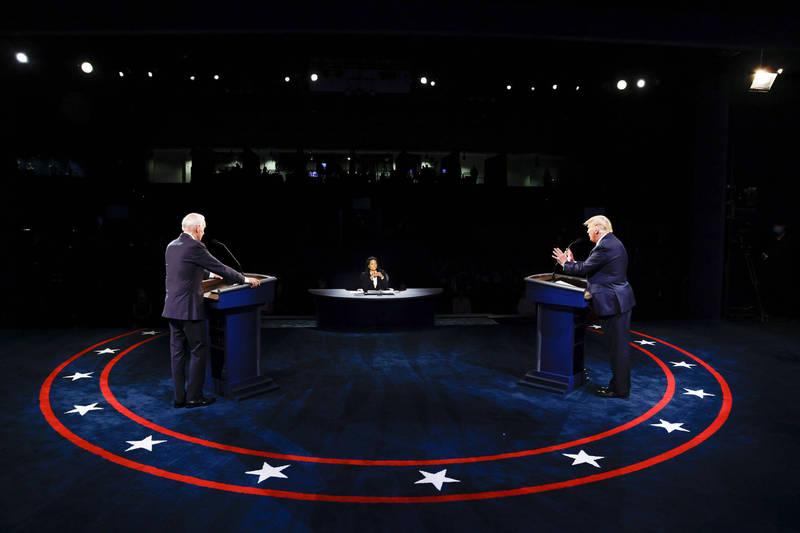美國總統川普與民主黨總統候選人拜登就移民政策展開攻防。(美聯社)