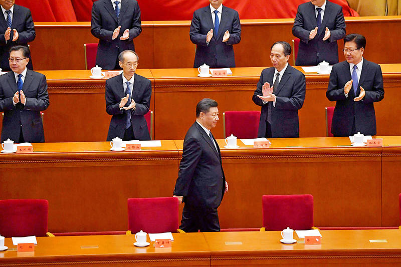 Chinese President Xi Jinping, front, is applauded yesterday as he arrives for a ceremony marking the 70th anniversary of China's entry into the Korean War, in Beijing's Great Hall of the People.  Photo: AFP