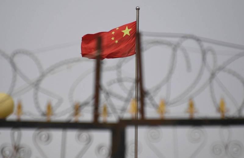 中國新疆喀什傳出1名武漢肺炎無症狀患者,當地民眾上網求救,直呼被困在家裡出不去了。(法新社)