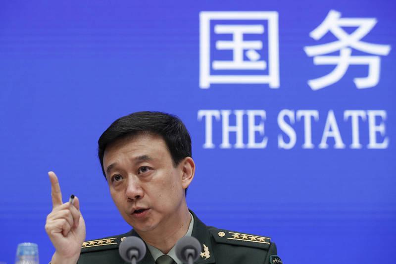 中國國防部發言人吳謙(見圖)今天透露,中國與美國軍方高層20日曾通電話,同意加強溝通管控,昨天至今天並舉行危機溝通視訊會議。(美聯社檔案照)