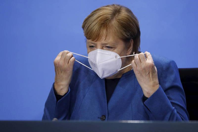 德國總理梅克爾宣布自下週一起實施1個月全國部分封鎖。(美聯社)