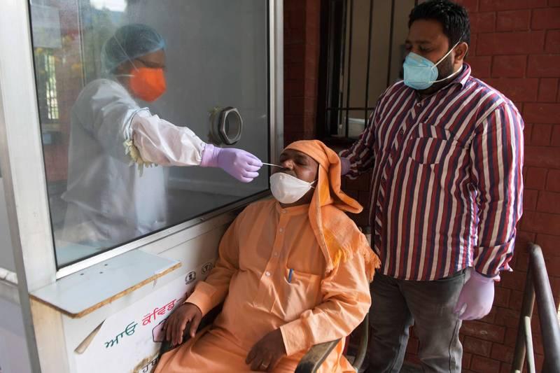 印度的武漢肺炎確診病例數量在今日突破800萬大關。(法新社)