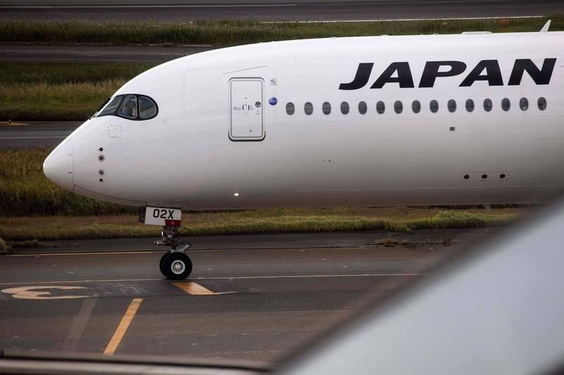 日本宣布有條件免除出差後回國的14天隔離措施。(法新社)