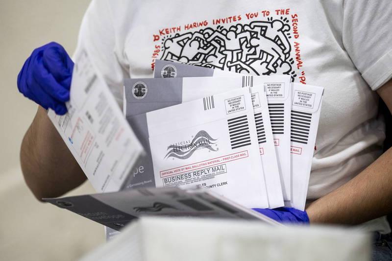 密西根州郵局內部人士爆料,主管下令將逾期廢票全蓋上11月3日的郵戳。美國郵寄選票示意圖。(歐新社檔案照)