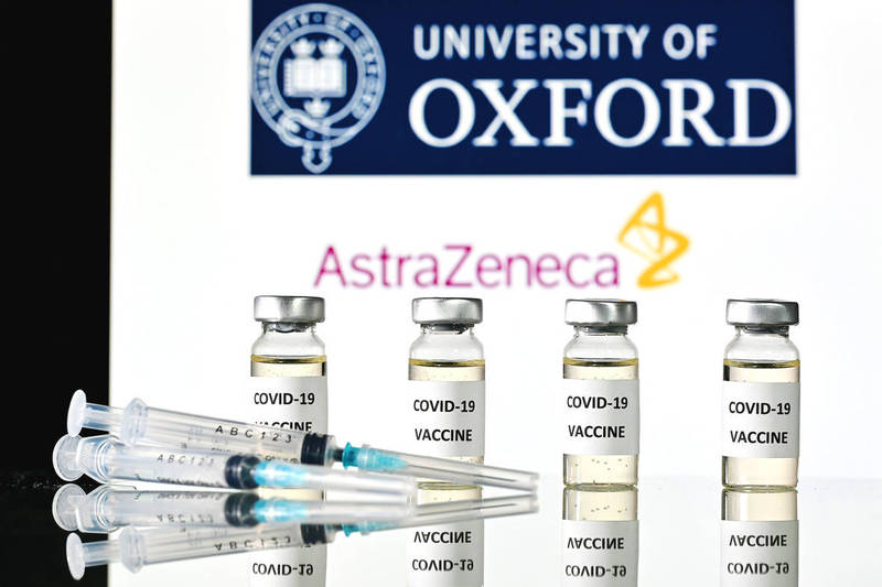 A promotional image shows vaccine vials and syringes with the University of Oxford and AstraZeneca logos on Tuesday. Photo: AFP