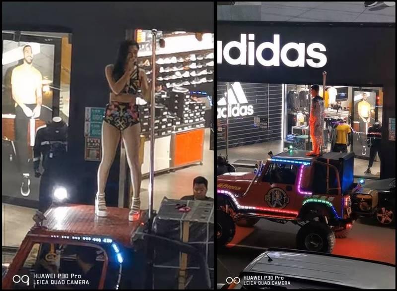 一名「吉普車鋼管女郎」在車上拿著麥克風說話,介紹後方一台車輛上被全身綑綁的男子剛好23歲生日。(圖擷自爆廢1公社)