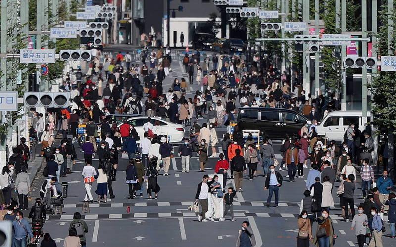 東京都今日新增391例,連續5日維持300例以上。圖為東京街景。(歐新社)