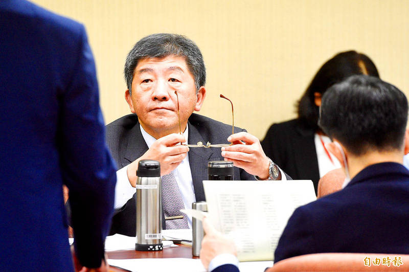 Minister of Health and Welfare Chen Shih-chung attends a meeting of the Social Welfare and Environmental Hygiene Committee yesterday at the Legislative Yuan in Taipei. Photo: George Tsorng, Taipei Times