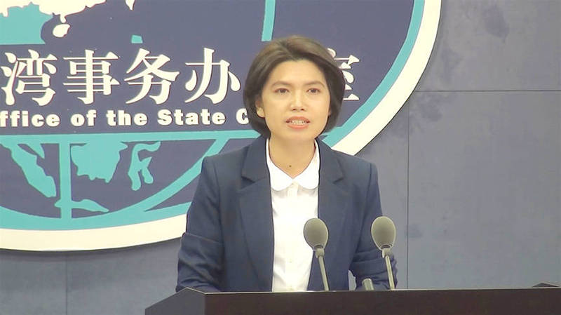 China's Taiwan Affairs Office spokeswoman Zhu Fenglian speaks at a new conference in Beijing yesterday. Photo: CNA