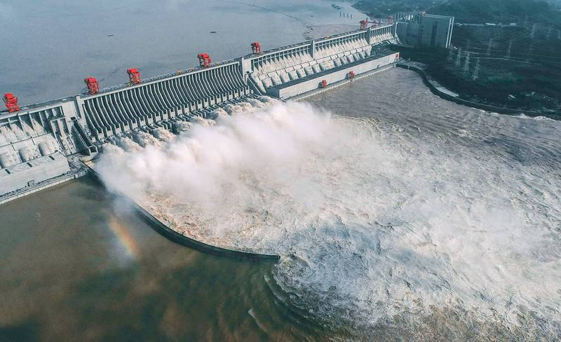 中國官方今年終於宣布三峽大壩通過驗收,但水利專家王維洛卻批評,根本是當權者的超級提款機。(法新社檔案照)