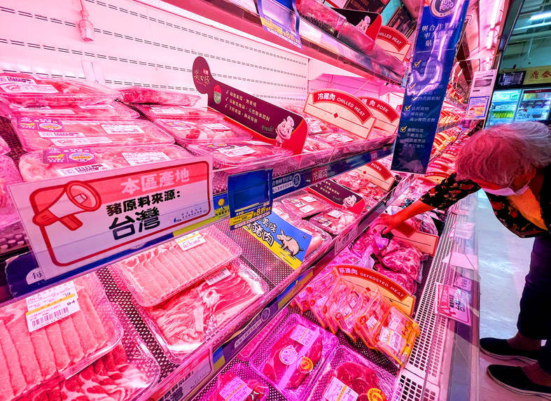 A woman browses Taiwanese pork products at a supermarket in Taipei yesterday. Photo: CNA