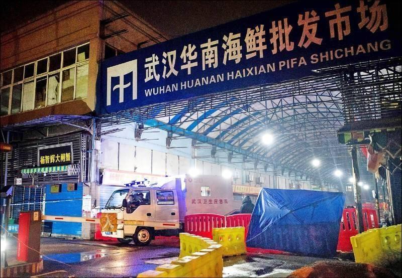 圖為最早傳出確診病例的中國武漢華南海鮮市場。(法新社檔案照)