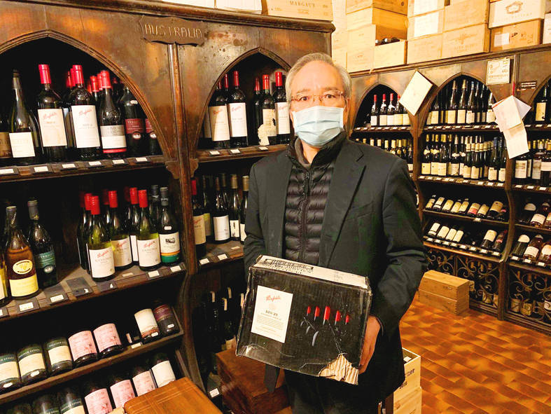 Ambassador to the Holy See Matthew Lee holds a box of Australian wine he purchased in Rome on Tuesday. Warning: excessive consumption of alcohol can damage your health Photo: screen grab from Facebook