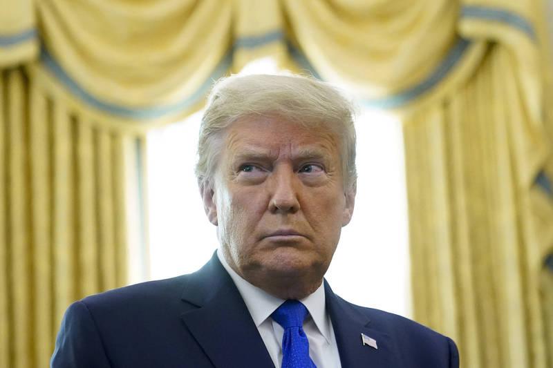 美國總統川普(圖)質疑共和黨籍的喬治亞州州長坎普(Brian Kemp)未對選舉投票進行簽名驗證。(美聯社)