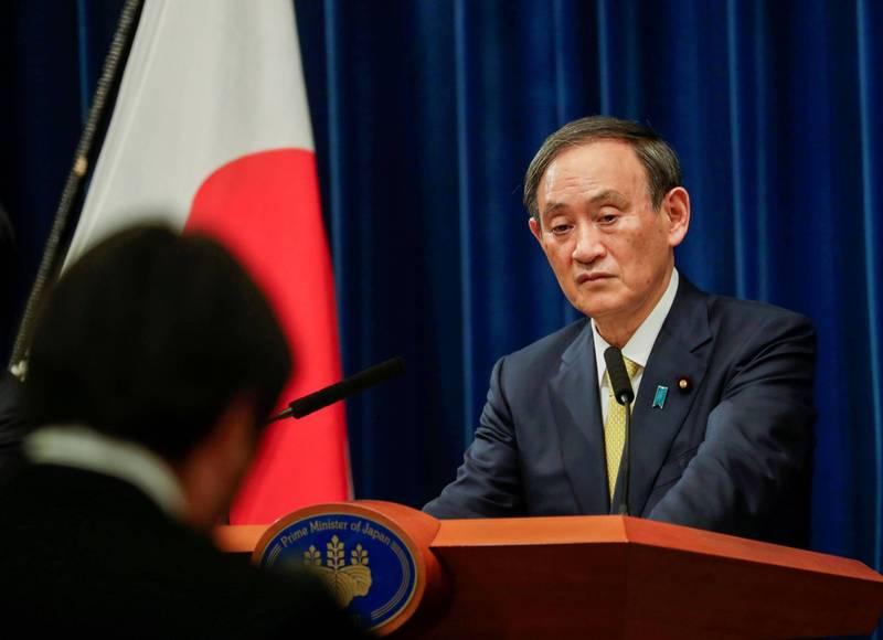 日本首相菅義偉被抓到參加年終聚餐,今日為此道歉。(路透)