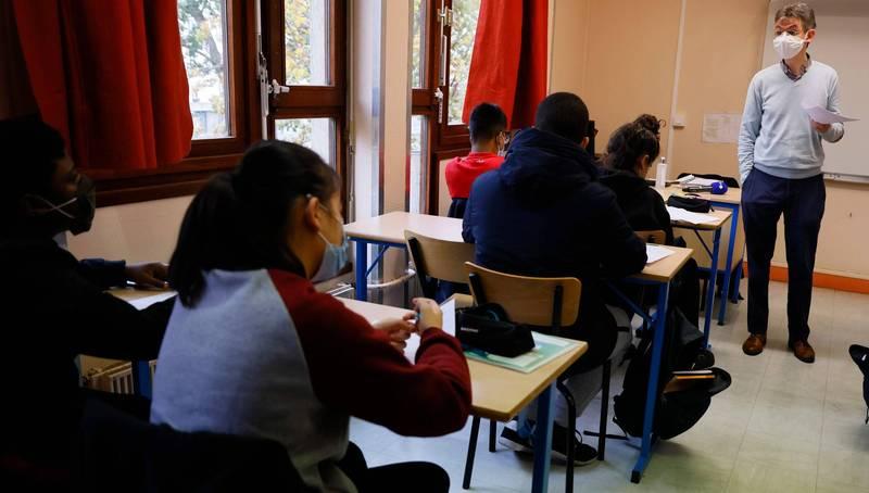 美國1名大學教授指出,1名中國女學生去世後持續交作業,嚇壞系上老師。大學課堂示意圖。(法新社檔案照)