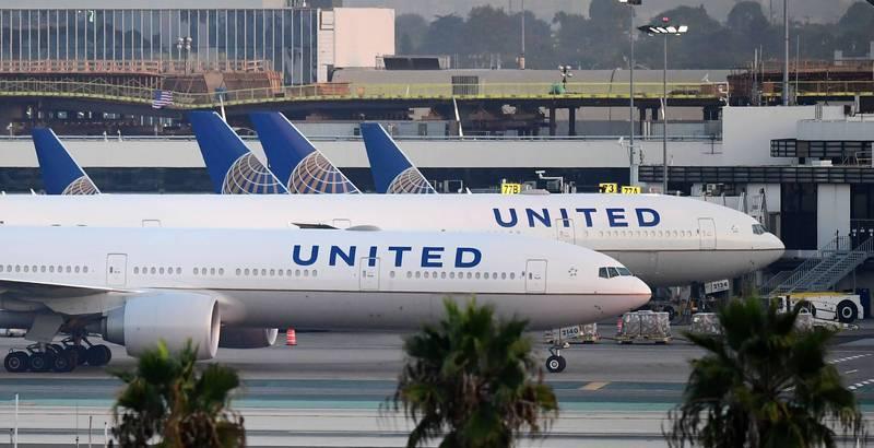 美国联合航空14日一架由奥兰多飞往洛杉矶的班机上,惊传有一名武汉肺炎患者猝逝。(法新社档案照)(photo:LTN)
