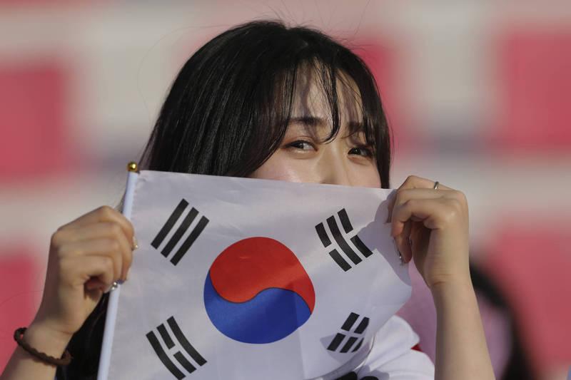 韓國女性為了就業與生活水準之間的平衡過得很掙扎。(法新社)
