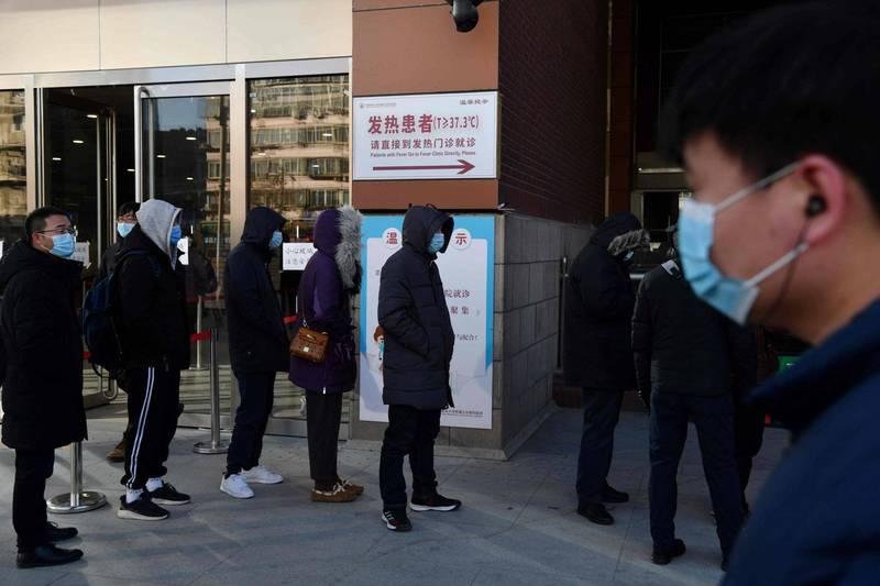北京在1月5日發現1例確診病例,大批人員到醫院接受檢測。(法新社)
